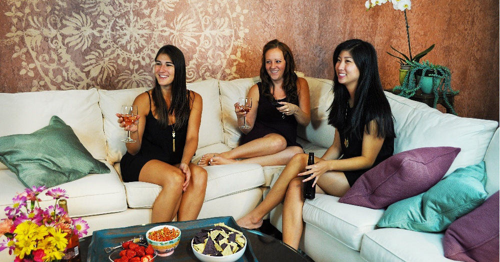 LiveSmart girls night on white sofa with performance fabric and wine