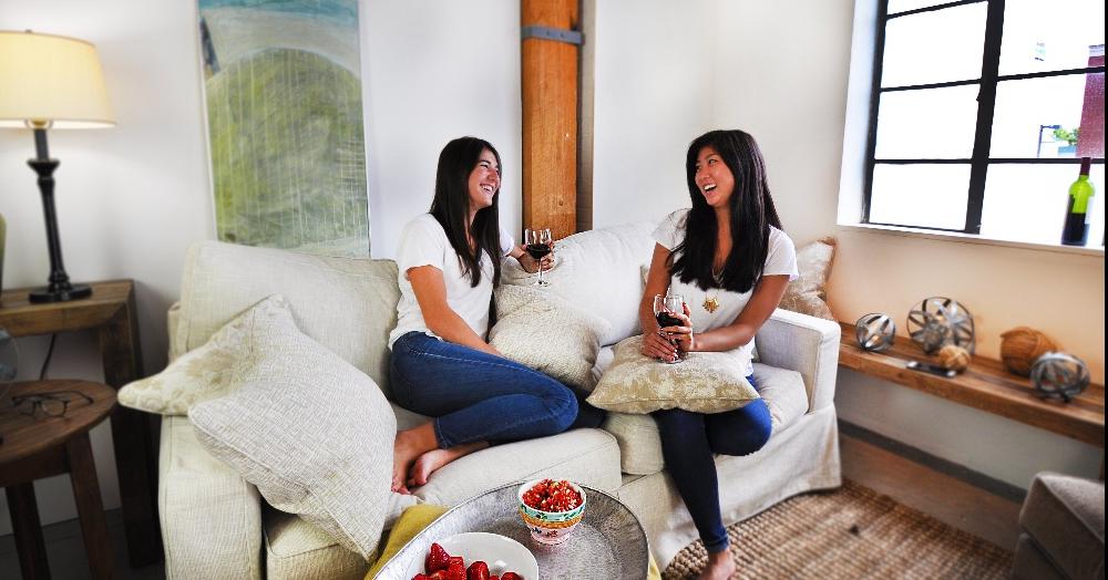 LiveSmart wine on white sofa